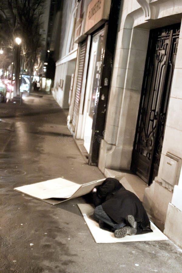 Parijse nacht, bedelaar stock foto's