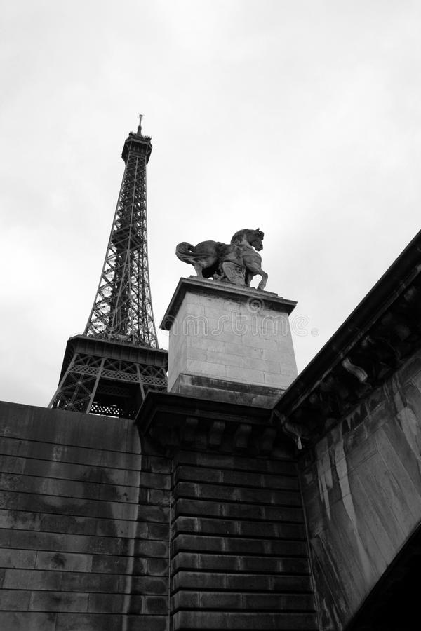 Paris. View of the Eiffel Tower and Parisian statue from the banks of the Seine River stock photo