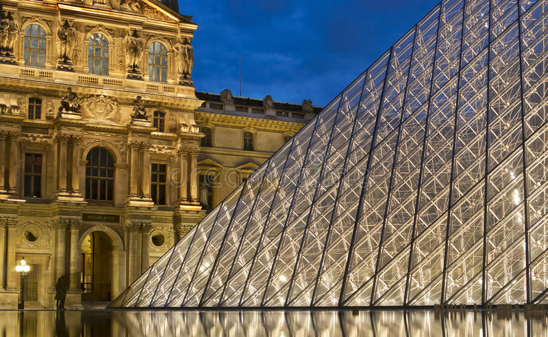PARIS-APRIL 25: The Louvre at dusk. This is the most visited museum in the world. Its history goes back 800 years of continuous transformations from fortress to stock photography