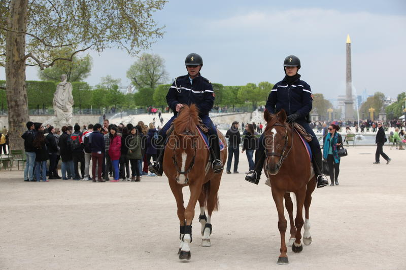 PARIS - APRIL 27: French police control the street Tuileries gar. Den, Paris the 27 april 2013, France. Paris is one of the most populated metropolitanareas in royalty free stock photography