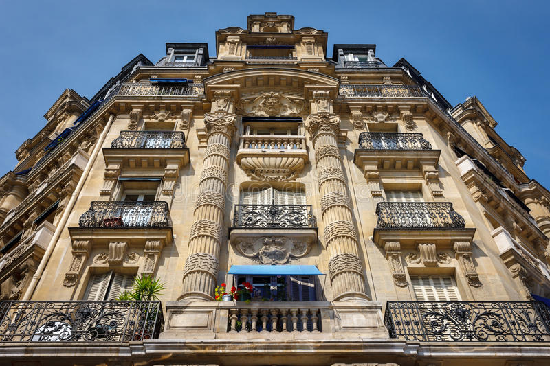 Paris architecture: haussmannian facade and ornaments royalty free stock image