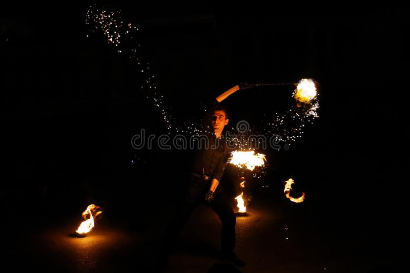 Fire performer with flail royalty free stock images