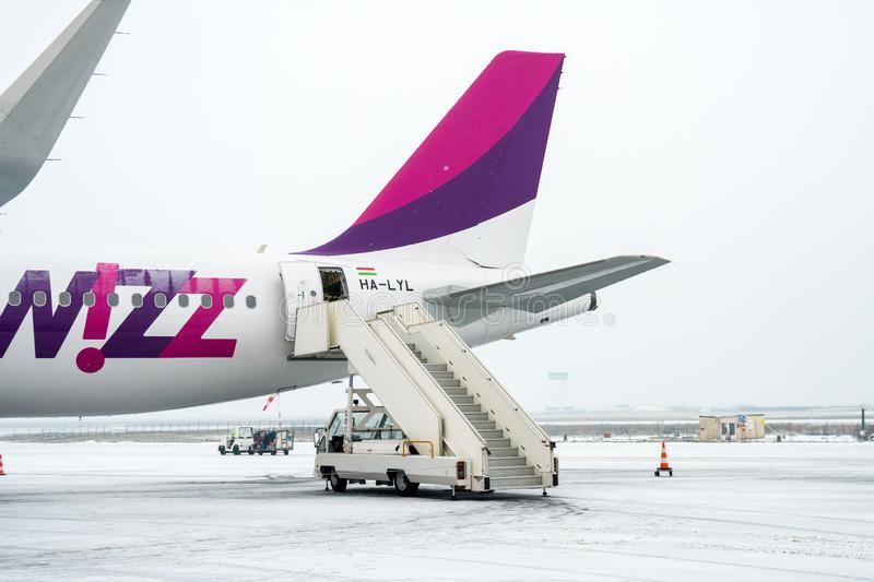 Paris Beauvais, France - 22.01.2019: Snow in International airport Beauvais. Airplane near terminal gate ready for takeoff royalty free stock image