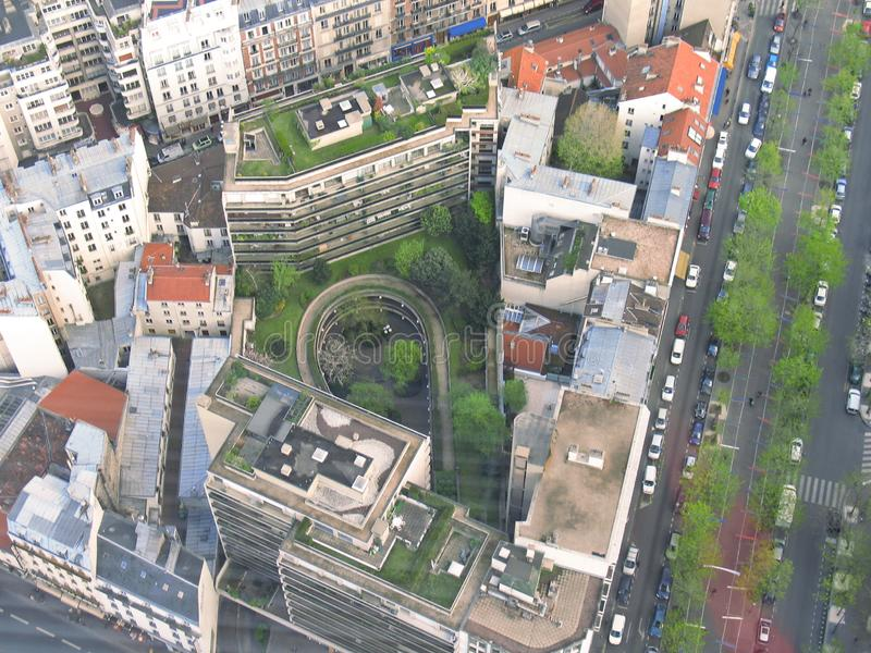 Paris bird eye view streets from Montparnasse tower. Traffic parking buildings stock photo