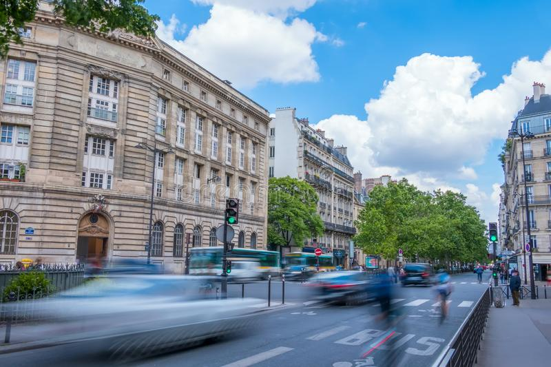 Paris Day Traffic on a Summer Day. France. Paris. Street in the city center with busy traffic. Summer day stock image