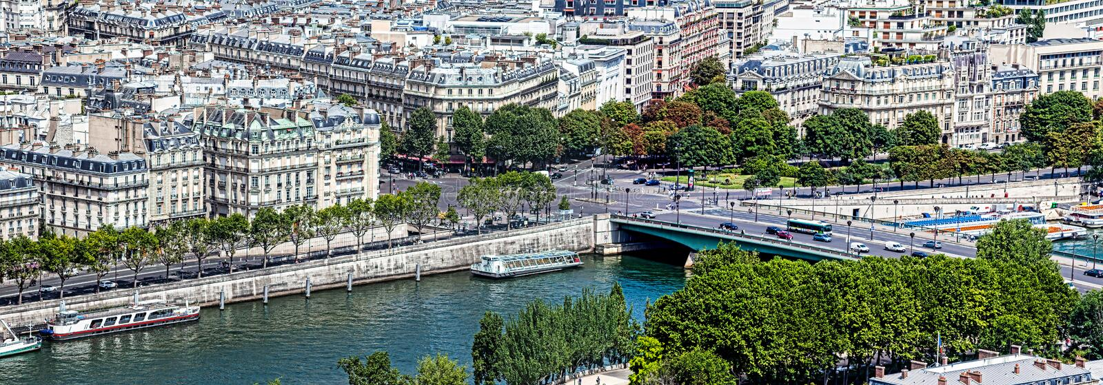A Paris day. A view of Paris and the apartments on the river from the Eiffel tower on a sunny summers day stock images