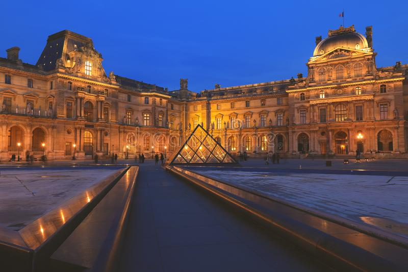 Louvre building at courtyard in the evening royalty free stock photos