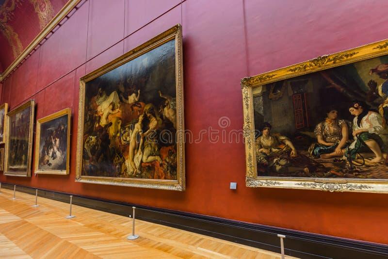 PARIS, FRANÇA - 18 de agosto de 2017: Imagens no museu do Louvre imagens de stock
