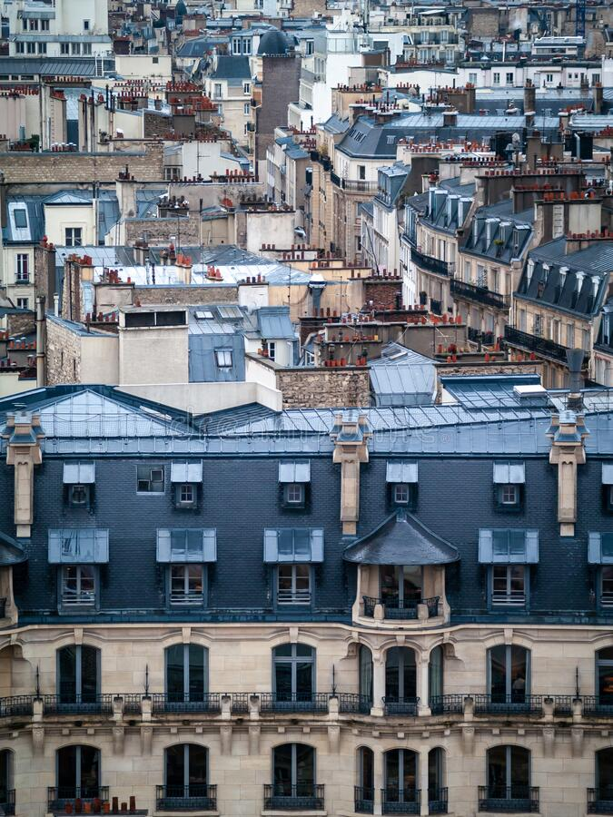 Paris, France aerial view of city old traditional classic buildings wet rooftops, a rainy winter day royalty free stock images