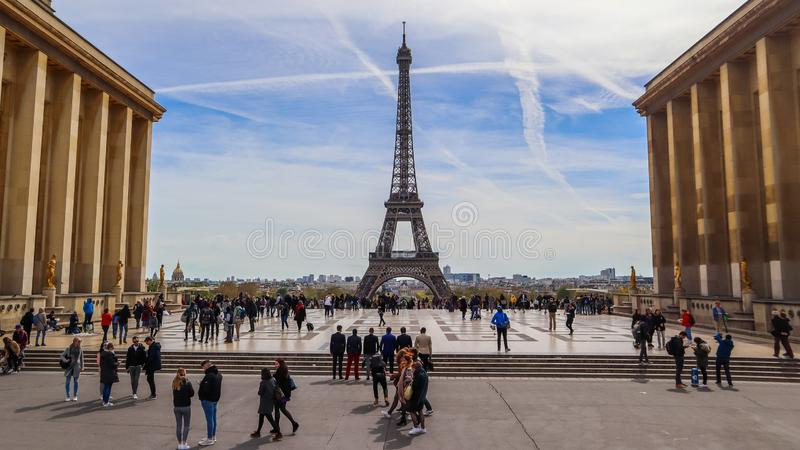 Paris / France - April 05 2019: Beautiful view of Eiffel Tower and cityscape from Trocadero. People at sweeping plaza of the stock images