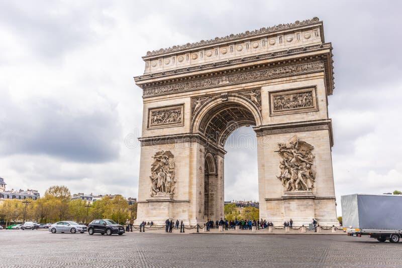 Paris, France - APRIL 9, 2019: Champs-Elysees and Arc de Triomphe on a cloudy day, Paris. France royalty free stock images