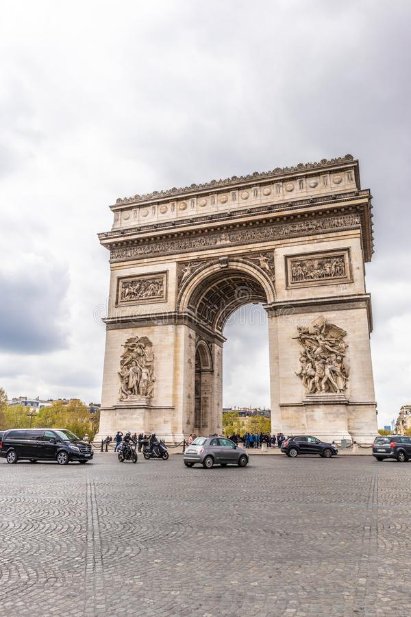 Paris, France - APRIL 9, 2019: Champs-Elysees and Arc de Triomphe on a cloudy day, Paris. France stock photo