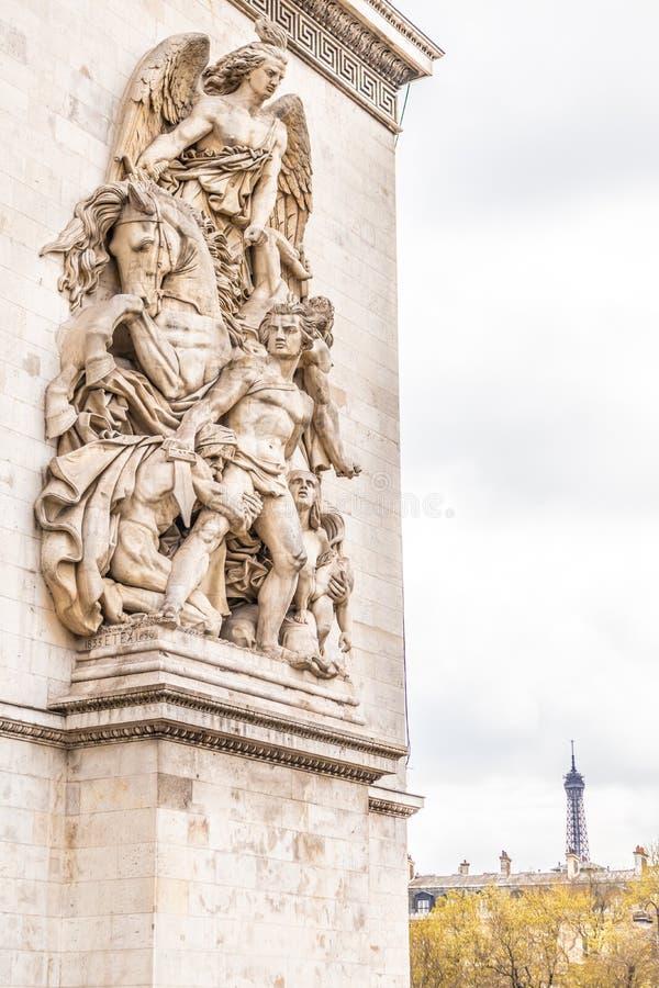 Paris, France - APRIL 9, 2019: Detais of the Arc de Triomphe on a cloudy day, Paris. France royalty free stock images