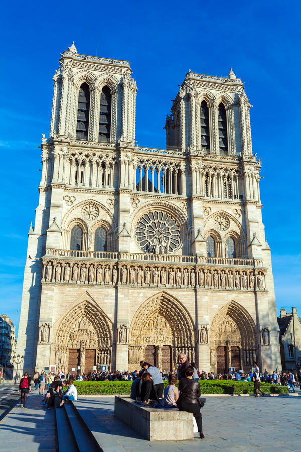 PARIS, FRANCE - APRIL 6, 2011: the French walk in front of Cathedral Notre Dame royalty free stock image