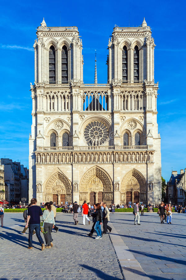 PARIS, FRANCE - APRIL 6, 2011: the French walk in front of Cathedral Notre Dame royalty free stock photography