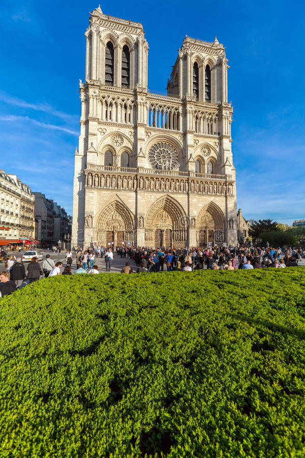 PARIS, FRANCE - APRIL 6, 2011: the French walk in front of Cathedral Notre Dame royalty free stock images