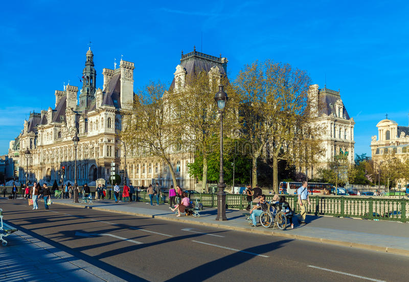 PARIS, FRANCE - APRIL 6, 2011: the French walk in front of Hotel royalty free stock image
