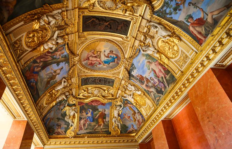Paris / France - April 05 2019. Inside of richly decorated louvre museum. Beautiful ceiling stock images