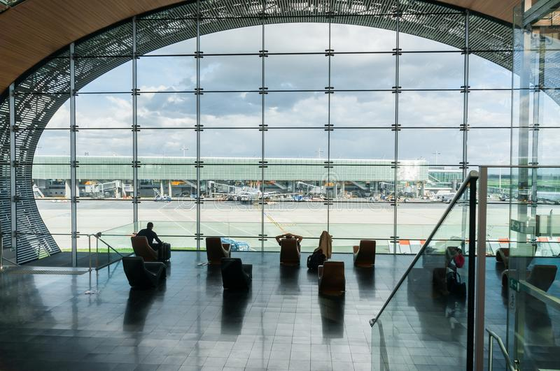 Paris, France, April 1 2017: Looking out a large ellipsoid window at Charles De Gaulle airport stock photography