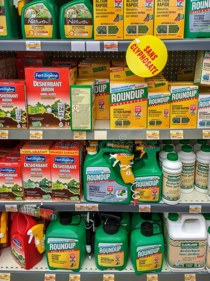 Paris, France - April 27, 2019 : Shelves with a variety of Herbicides in a french Hypermarket. Roundup is a brand-name of an herbi. Cide containing glyphosate royalty free stock photo