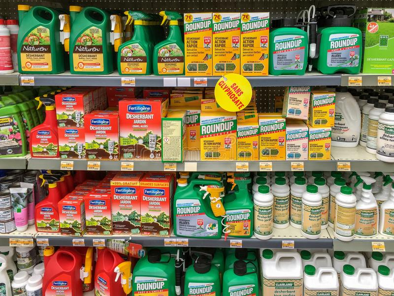Paris, France - April 27, 2019 : Shelves with a variety of Herbicides in a french Hypermarket. Roundup is a brand-name of an herbi. Cide containing glyphosate royalty free stock image