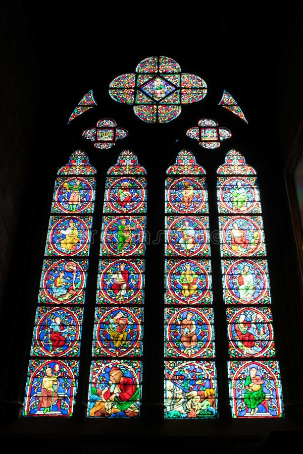 Paris, France - April 1, 2019: Stained glass window inside the Notre Dame Cathedral, Paris, France stock photo