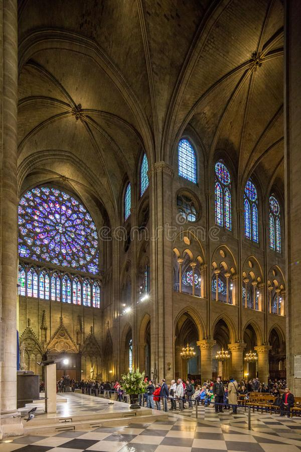 Paris France April 29th 2013 Interior view of Notre Dame Cathedral, including the famous stained glass windows stock photo