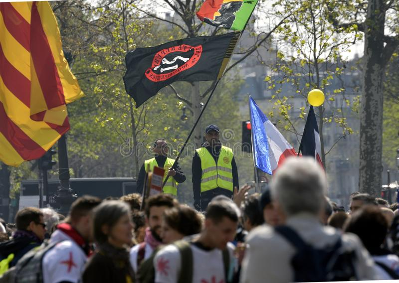 `Vests Yellow` Before the start of the protest march. Paris, France - April 6, 2019. `Yellow Gilets` in protest march. Departure of the event in Piazza della stock photos