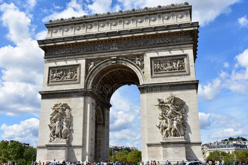 Paris, France. August 2018. The Arch of Triumph is surrounded by a crowd of tourists. stock photography
