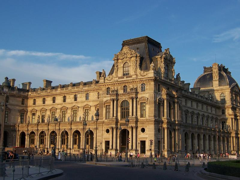 Paris, France-August 05, 2009: Beautiful old architecture of the Louvre building at sunset on a summer evening stock images