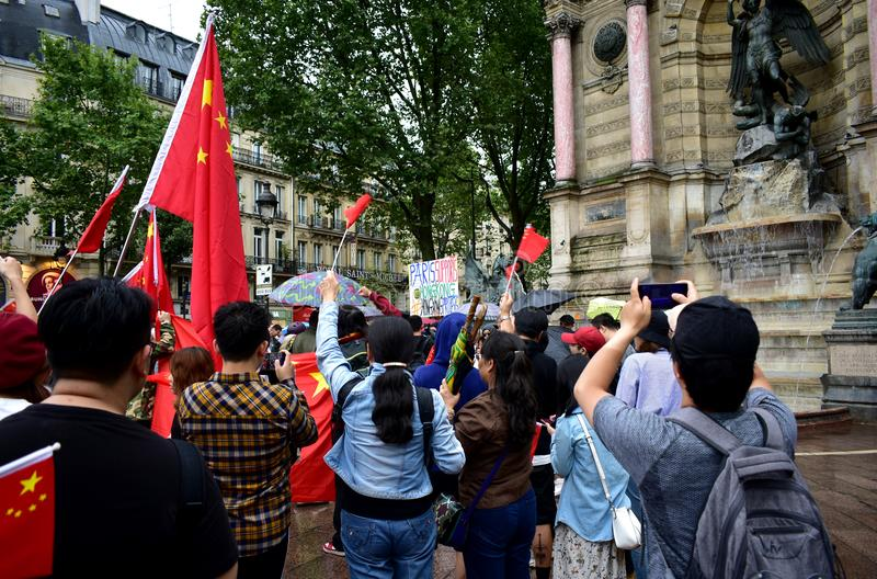 Counter-protesters with chinese flags and demonstrators gathering to support pro-democracy protests in Hong Kong. Paris, France. stock images