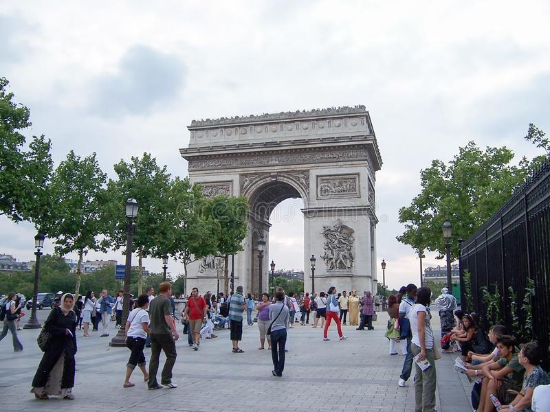 Paris, France-August 07, 2009: A crowd of tourists and citizens walking near the arc de Triomphe Paris Champs Elysees stock photo