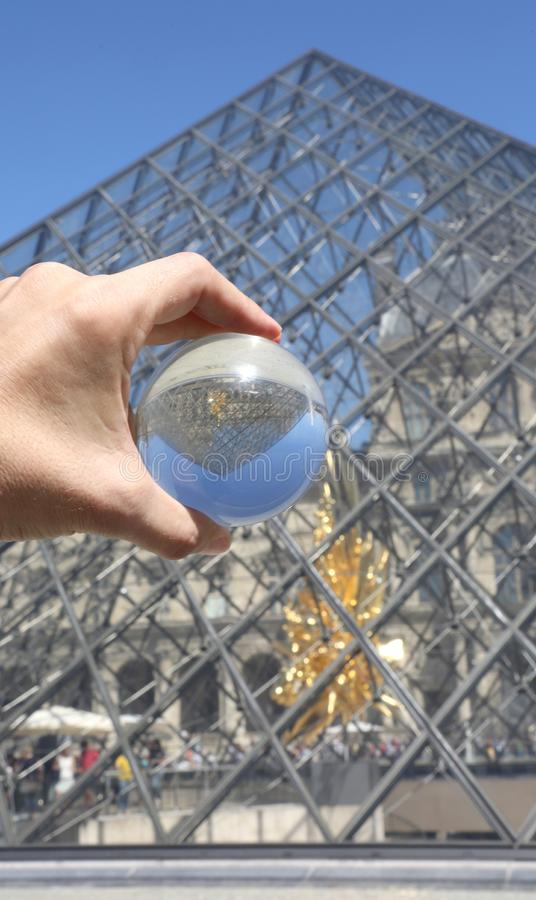 Paris, France - August 18, 2018: Glass Sphere and the Pyramid of stock image