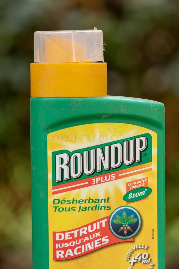 Paris, France - August 15, 2018 : Herbicide in a french garden. Roundup is a brand-name of an herbicide. Containing glyphosate, made by Monsanto Company royalty free stock photo