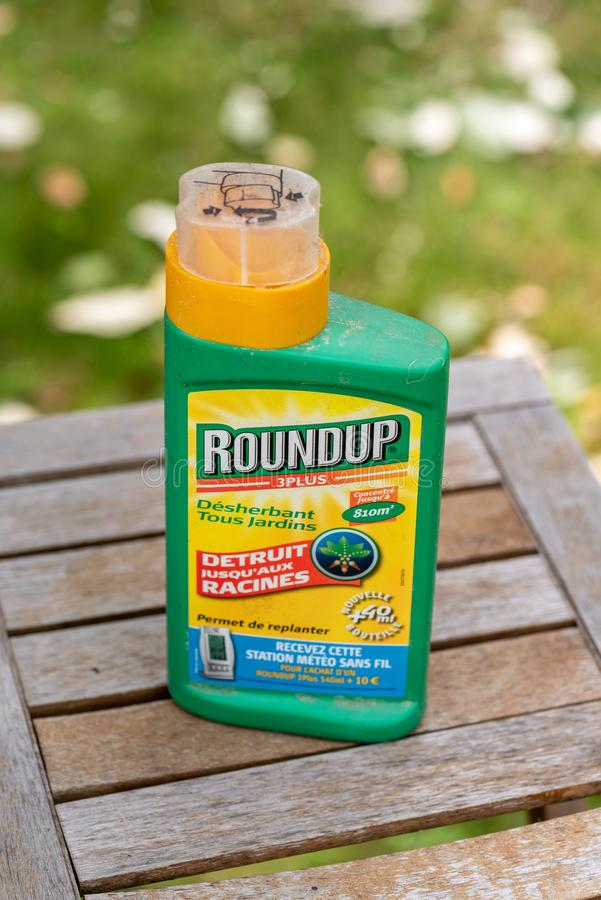 Paris, France - August 15, 2018 : Herbicide on a wooden table in a french garden. Roundup is a brand-name of an herbicide containi. Ng glyphosate, made by stock photos