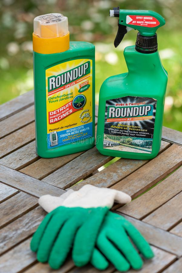 Paris, France - August 15, 2018 : Herbicide on a wooden table in a french garden. Roundup is a brand-name of an herbicide containi. Ng glyphosate, made by royalty free stock photos