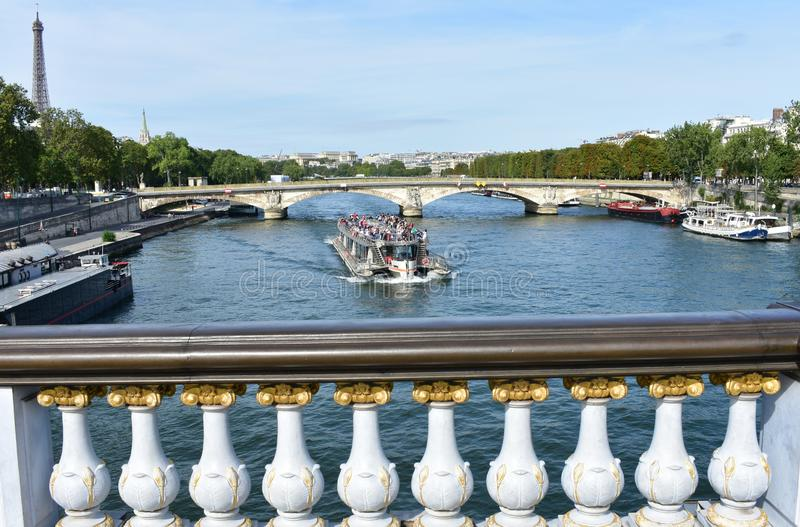 View from Pont Alexandre III with Eiffel Tower and tourist boat. Paris, France. royalty free stock photos