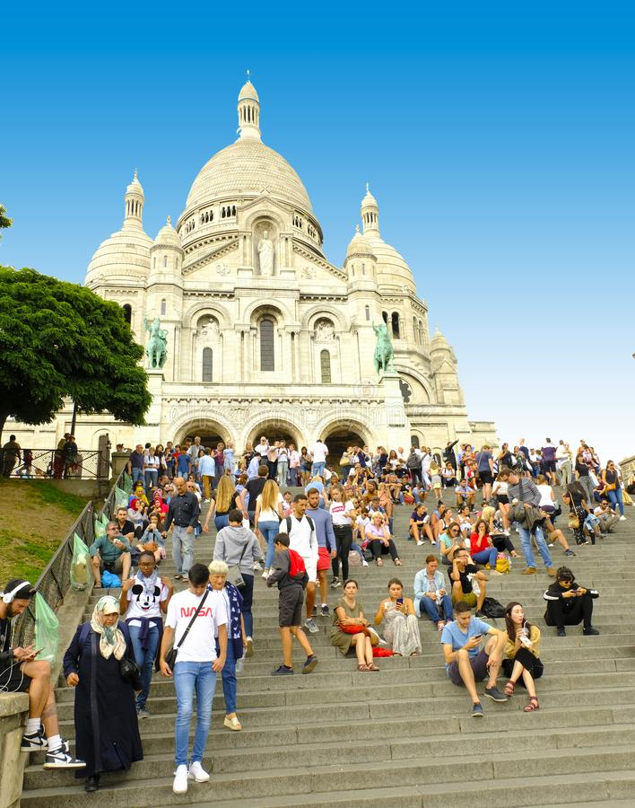 Tourists rest on the steps in front of the Sacre-Coeur Basilica, Montmartre, Paris, France stock images