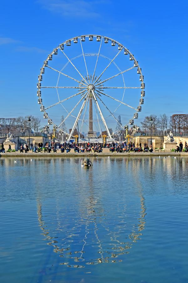 Big Wheel Grande Roue de Paris at Place de la Concorde reflected in water from Tuileries Garden in Paris, France, stock photography