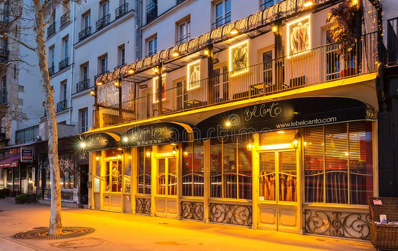 Bel Canto is traditional French restaurant and service from Opera singing waiters, Paris, France. stock photography