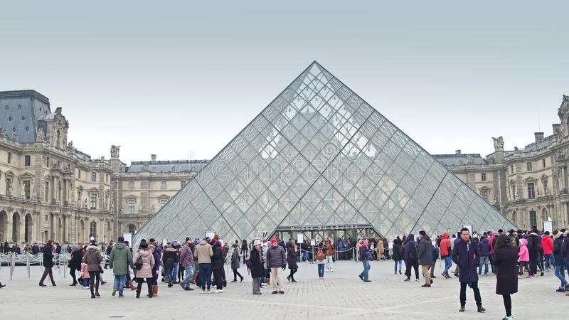 PARIS, FRANCE - DECEMBER, 1, 2017. Louvre entrance on a cloudy day. Famous French museum and popular touristic royalty free stock photo