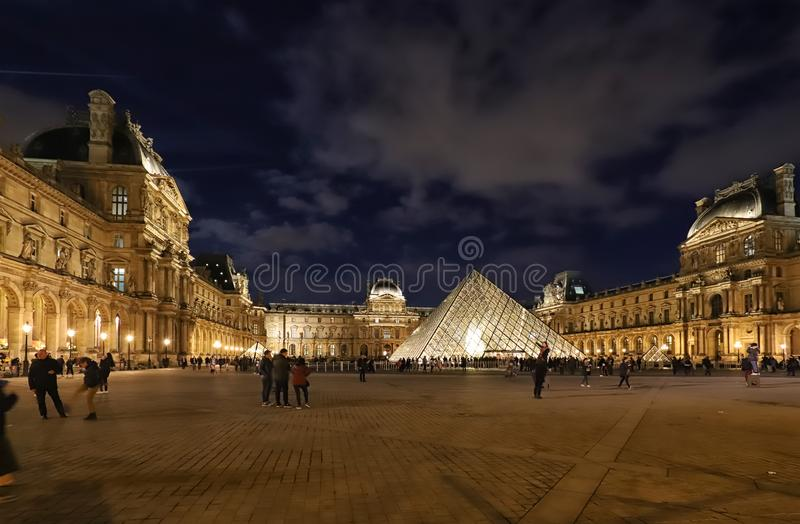 The Louvre Pyramid based in the main courtyard cour Napoleon of the Louvre Palace in Paris. It royalty free stock image