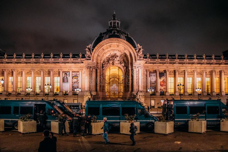 French police vans in front of Petit Palais in Paris at night following nights of protests by gilets jaunes stock images