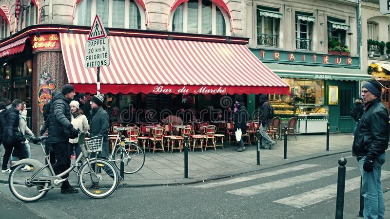 PARIS, FRANCE - DECEMBER, 31, 2016. Parisian cafe with awning and urban traffic at road intersection. PARIS, FRANCE - DECEMBER, 31, 2016. Parisian cafe with stock photo