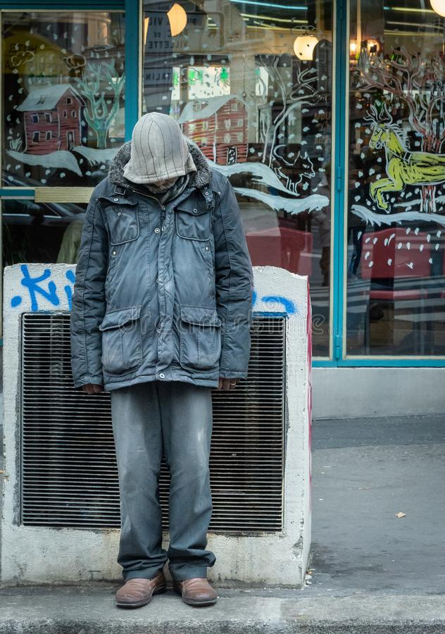 Paris, France. 10-December-2018. Portrait of a homeless man in front of a shop during Christmas royalty free stock images