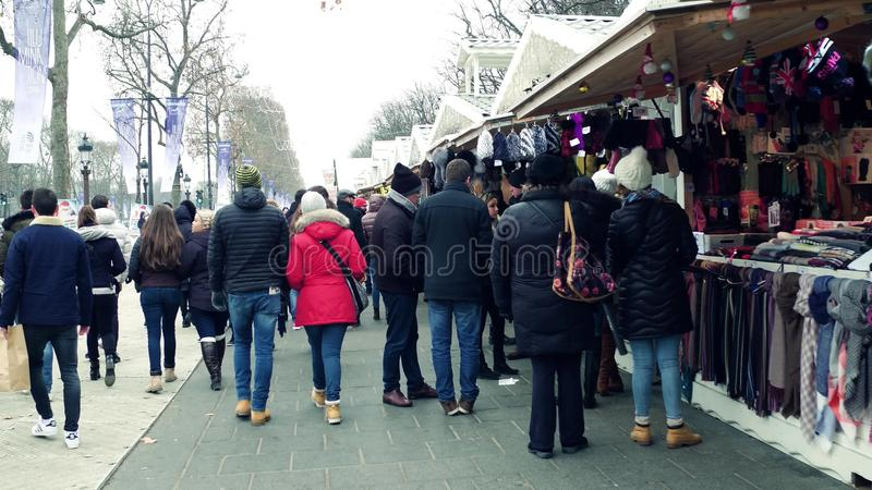 PARIS, FRANCE - DECEMBER, 31, 2016. Steadicam shot of crowded Christmas and New Year market. Souvenir stalls stock images