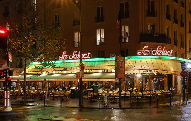 The typical Parisian cafe Le Select decorated for Christmas in the heart of Paris. Christmas is one of the main Catholic stock image