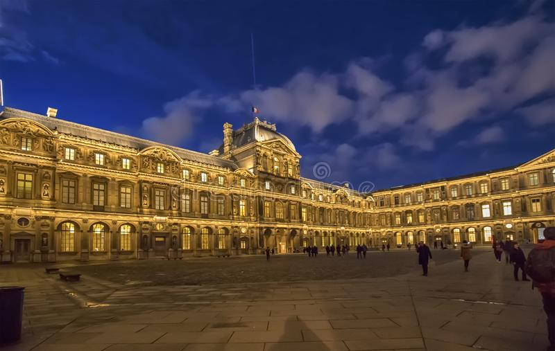 The Louvre Museum inner courtyard illuminated at night. Paris, France - Decembre 21, 2018: The Louvre Museum inner courtyard illuminated at night stock photo