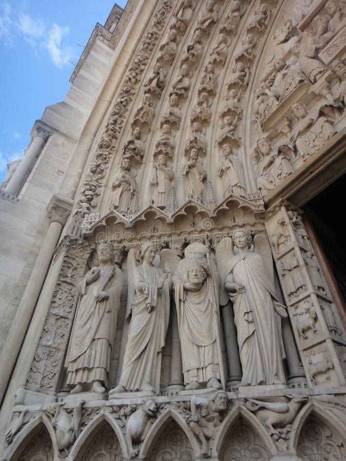 Paris, France - famous Notre Dame cathedral facade saint statues. UNESCO World Heritage Site. royalty free stock images