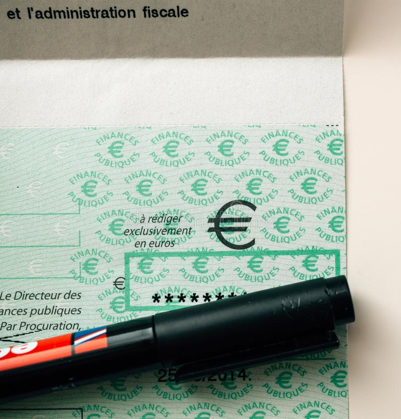 Taxes in France cheque issued by the Direction Generale des Fina royalty free stock image
